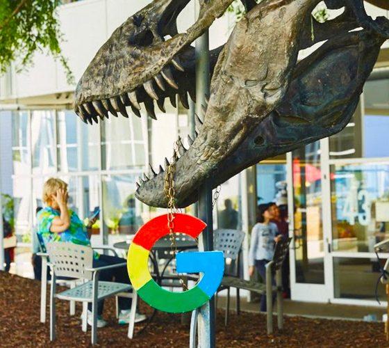 Dino holding Google logo on campus.