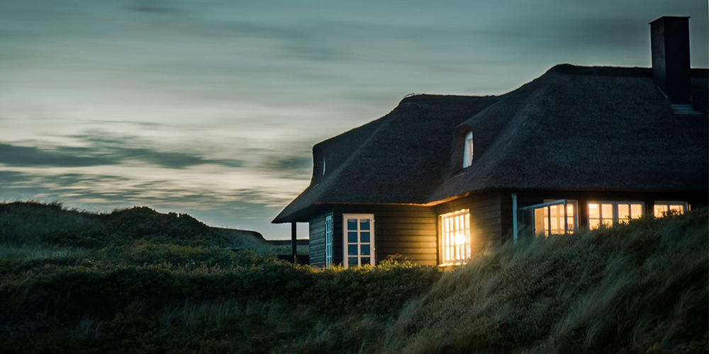 Dark house at dusk, a possible pocket listing to be snatched up.