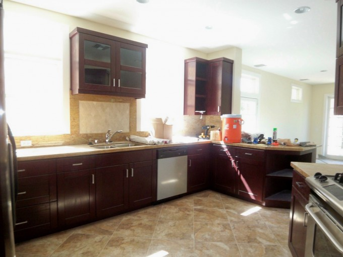 This new construction kitchen is beautiful, but lacks warmth and emotion with its cold, hard surfaces.