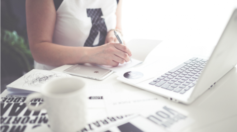 woman working laptop sheets