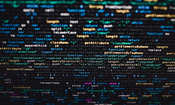 Code on screen, powering AI technology
