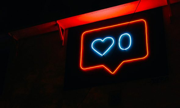 Neon social media like heart with a 0