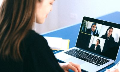 Woman networking through Zoom video call with two other women.