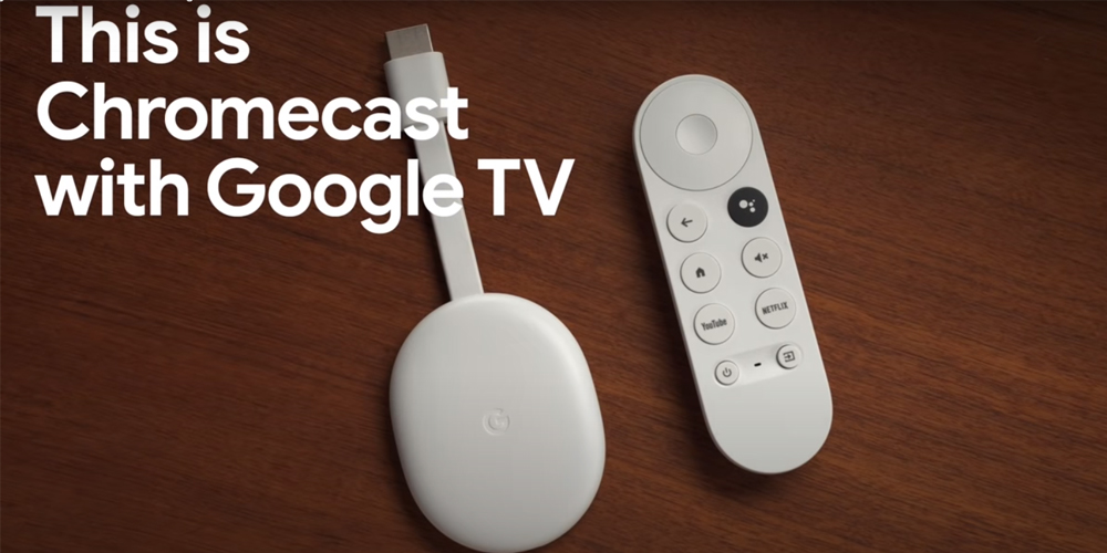 Chromecast with Google TV on a wooden background.