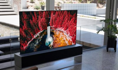 LG's rollable TV on display in a minimalist living room.