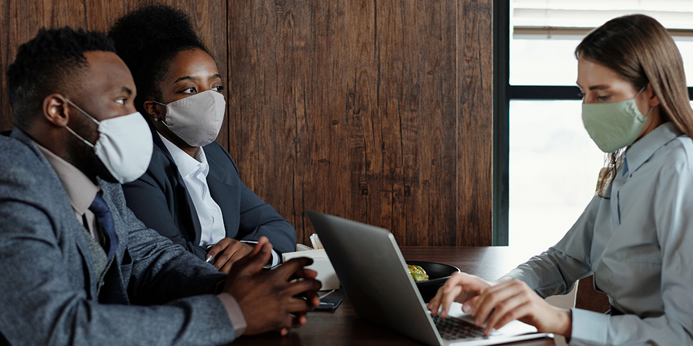 Masked people in meeting, but employers may find it hard to keep safe