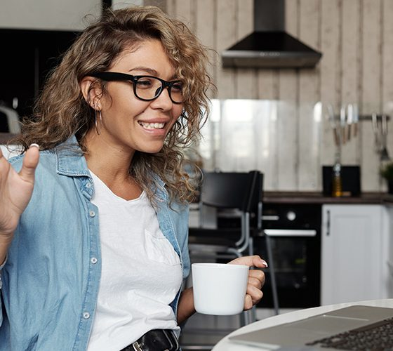 Woman on video call with coffee, NVIDIA video conference tech coming soon