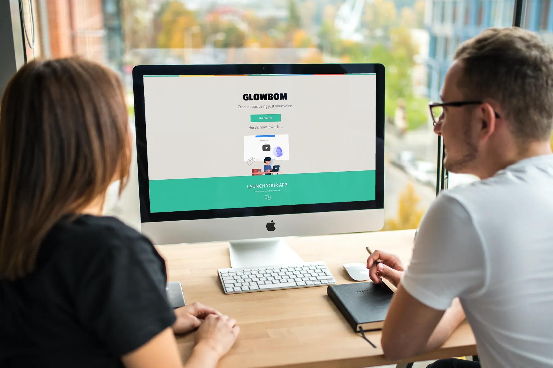 Colleagues looking at Glowbom website homepage